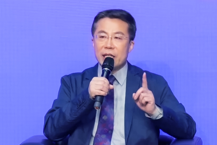 Lu Chuncong, deputy director of the MIIT's Information and Communication Administration, speaks at a conference on May 29. Photo: CCTV