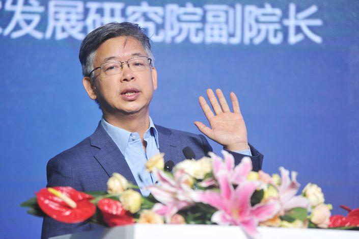 Huang Yiping, a deputy dean of the National School of Development at Peking University