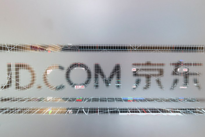 The logo for JD.com Inc. is displayed on a pane of glass at the company's headquarters in Beijing on  Oct. 23, 2017. Photo: Bloomberg