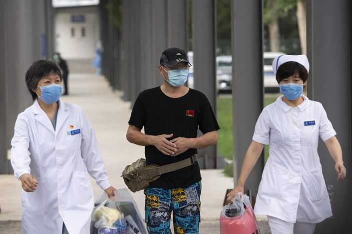 A Covid-19 patient being discharged from Beijing Ditan Hospital on June 29.