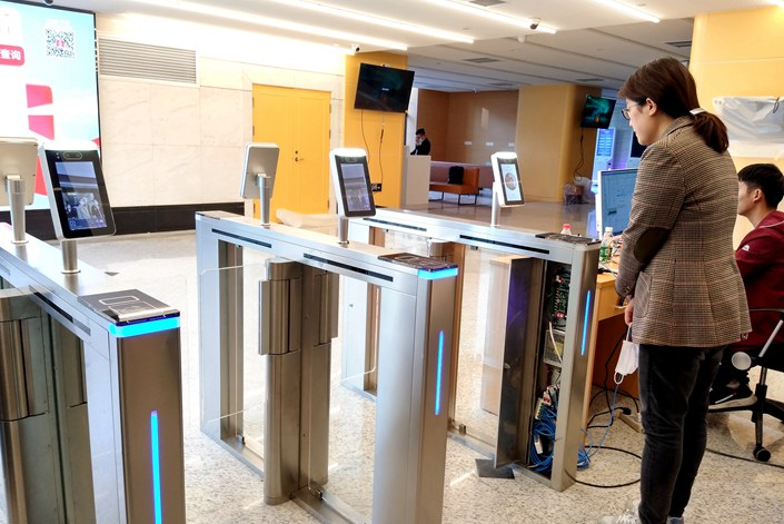 A facial recognition system is installed at the entrance of a government office in Shanghai on Nov. 12.
