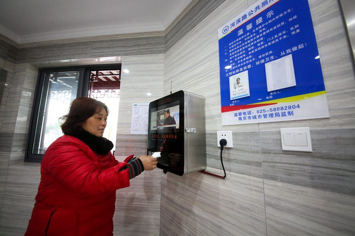 A face-scanning toilet paper dispenser in Nanjing, Jiangsu province, on March 19.