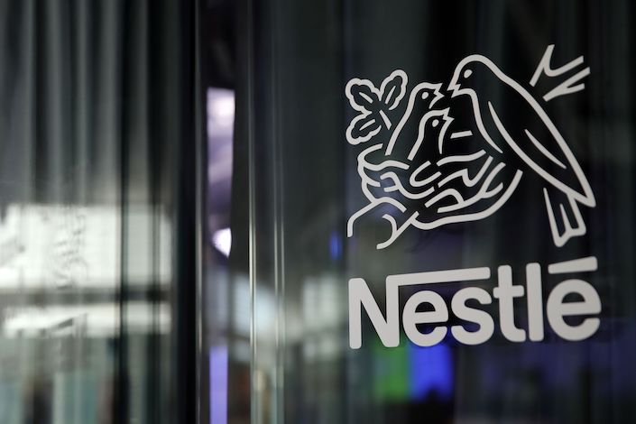A bird's nest logo sits on display at the Nestle SA headquarters in Vevey