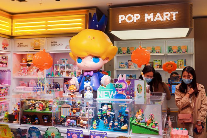 Shoppers look around a Pop Mart store in Shanghai in Oct. 31. Photo: IC Photo