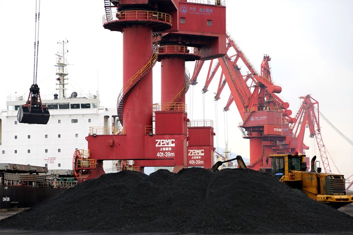Coal is transported at a terminal in Lianyungang, East China's Jiangsu province, Dec. 13.