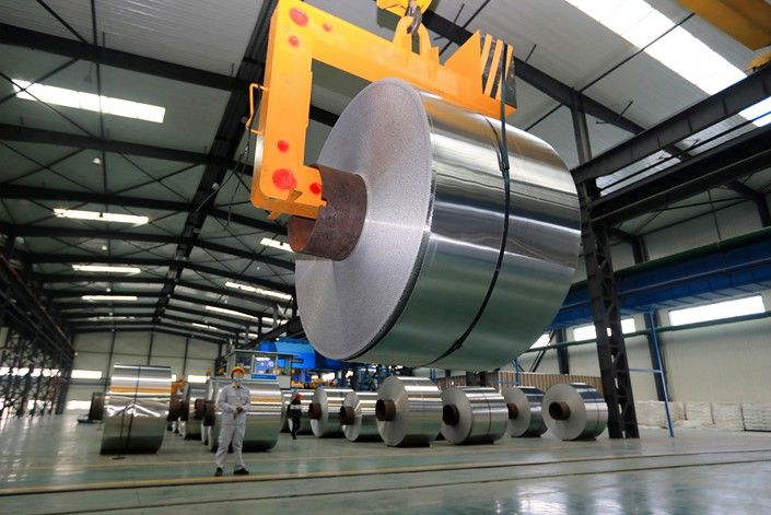 A worker produces high-precision aluminum strip foil on Dec. 3 at a workshop in Huaibei, East China's Anhui province.