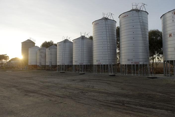 Barley silos stand at a grain facility at Balliang, Victoria, Australia, on May 18. Photo: Bloomberg