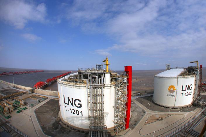 LNG storage tanks stand at Yangkou Port in Nantong, East China's Jiangsu province, in January 2014.