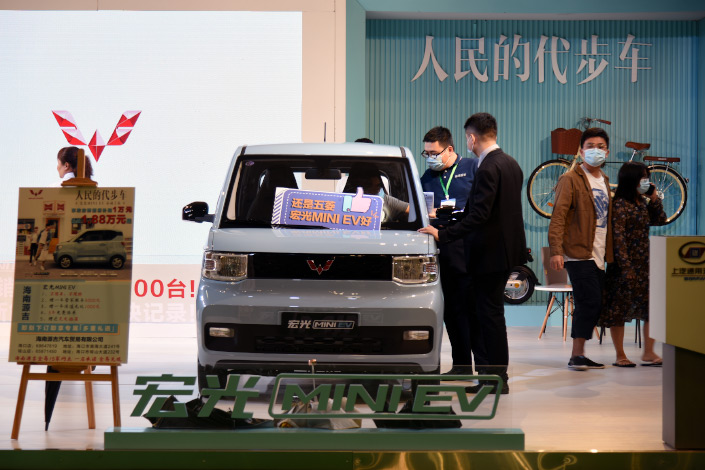 A visitor checks out a Wuling Mini EV on Oct. 25 at an exhibition in Haikou, South China's Hainan province.