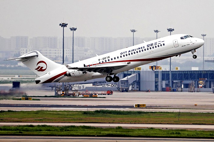 Short for One Two Three, OTT Airlines flew from Shanghai to Beijing for its maiden passenger flight on Monday.