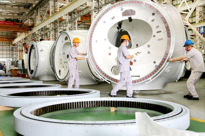 Workers make a wind turbine in Lianyungang, Jiangsu province.
