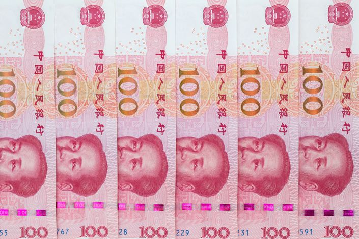 Chinese 100 yuan banknotes are arranged for a photograph in Hong Kong on April 23, 2020. Photo: Bloomberg