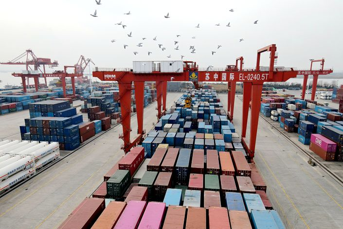 Items are loaded and unloaded at Rugao Port in East China's Jiangsu province on Jan. 21.
