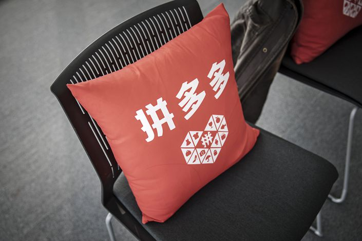 The Pinduoduo logo is seen on a cushion at the company's office in Shanghai