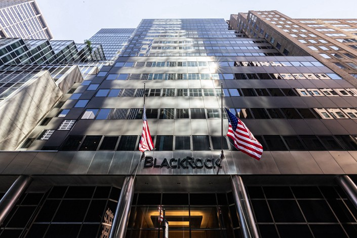 American flags fly at the entrance to BlackRock Inc. headquarters in New York