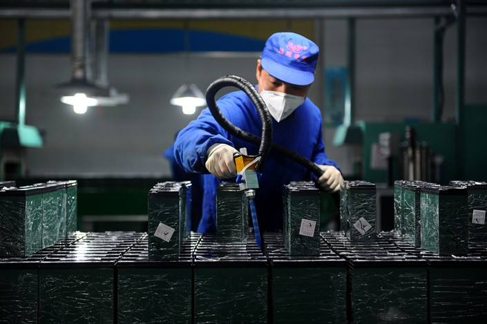 Workers produce lithium batteries for new-energy vehicles in Huzhou, Zhejiang province.
