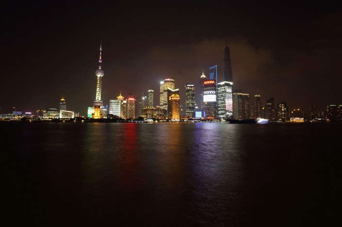 Buildings light up the Shanghai skyline in the Lujiazui financial district. Photo: Bloomberg
