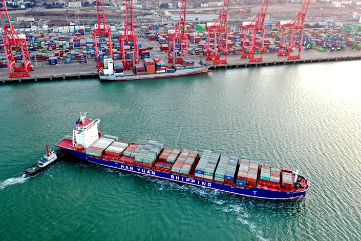 A container ship sits off the port of Lianyungang in East China's Jiangsu province on Jan. 7.