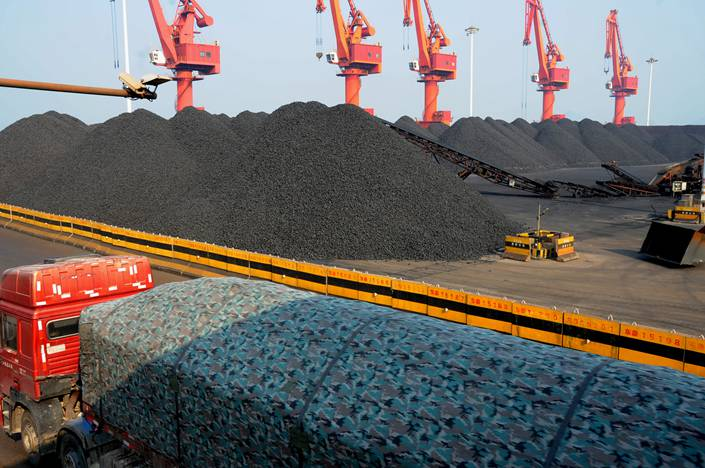 Vehicles haul imported coal at a terminal at the port of Lianyungang on Dec. 19.