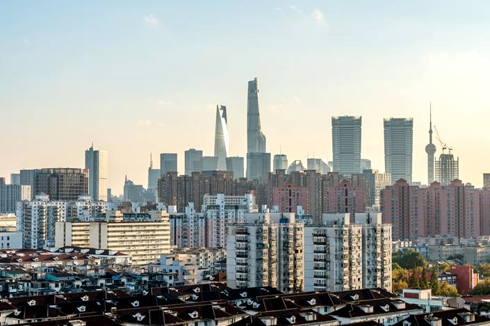 Residential buildings are seen against the Shanghai skyline.