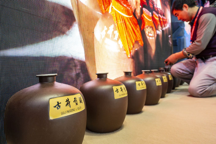 A collection of jars labelled Gujing Gong Wine sit on display at a wine expo in Shanghai in November 2018.