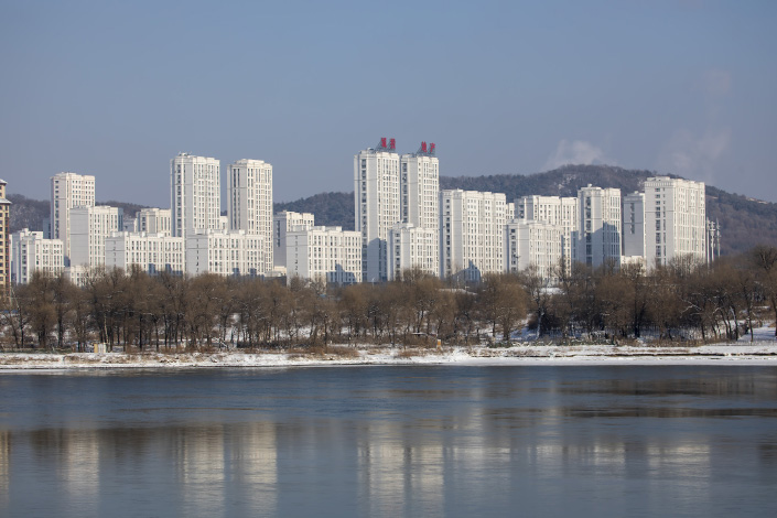 Residential buildings stand beside the the Songhua River on Saturday in Jilin City, Northeast China's Jilin province.
