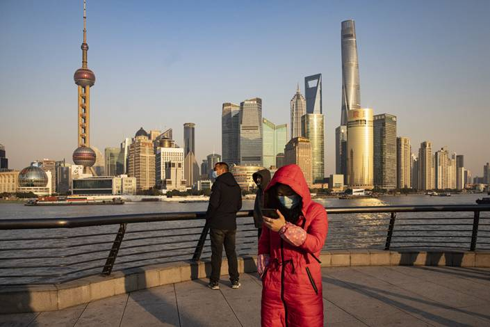 Visitors on the Bund in Shanghai on Dec. 21, 2020. Photo: Bloomberg