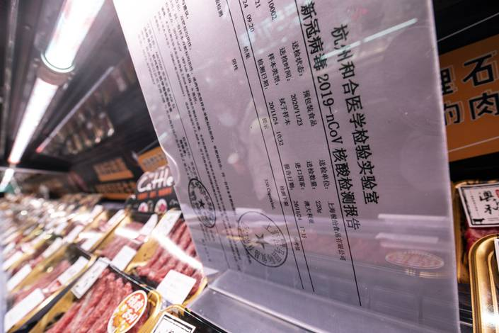 A Covid-19 test certification at the meat section in a Beijing supermarket. Photo: Bloomberg
