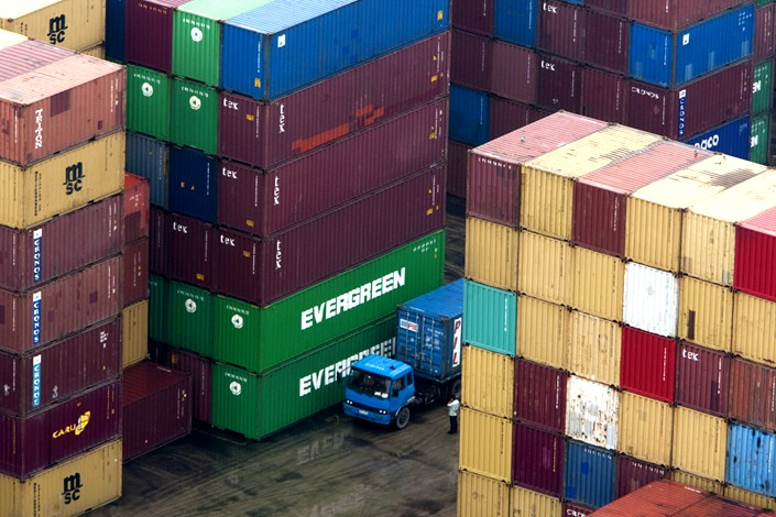 Containers are stacked at the Dayaowan Bonded Port Area in Dalian, LiaoningpProvince,on Sept. 15, 2011.  Photo: Bloomberg