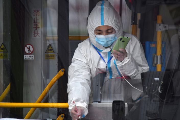 A medical worker verifies a resident's personal information in Tonghua, Northeast China's Jilin province.
