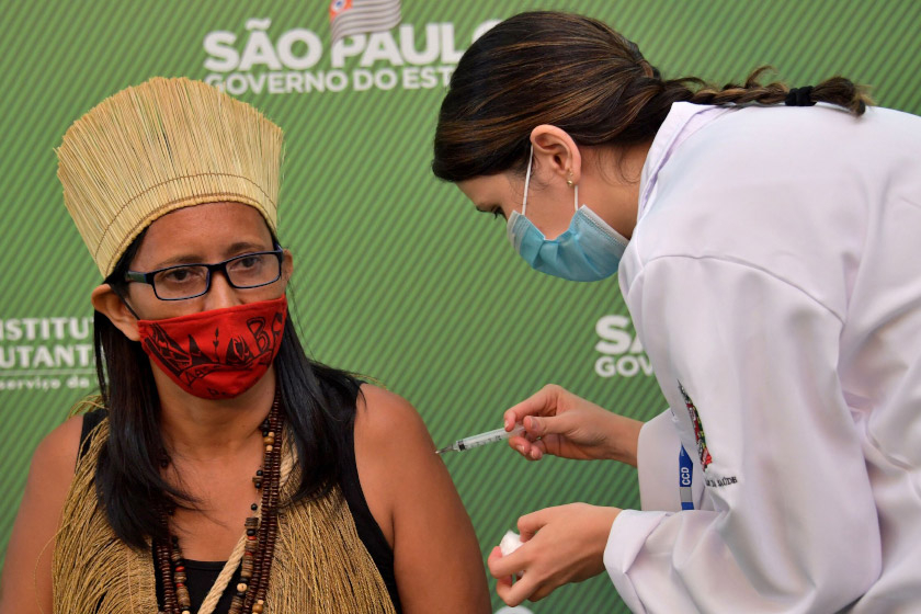 A resident receives an injection Sunday of the Covid-19 vaccine developed by Sinovac Biotech Ltd. at the University of Sao Paulo Hospital in Sao Paulo.