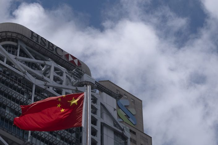The flag of China flies near the HSBC Holdings Plc building