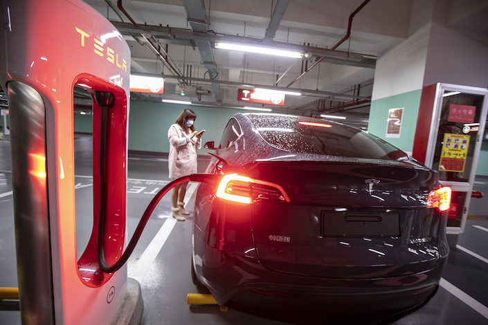 A Tesla car at a charging station in Shanghai.
