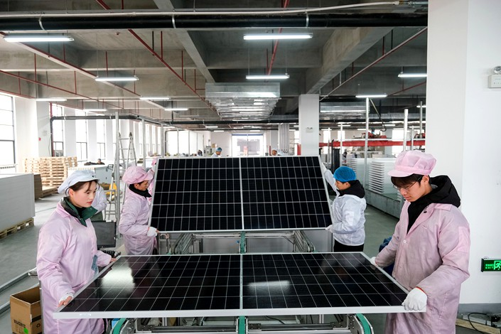Workers check photovoltaic panels on Jan. 6 at a factory of a smart-solar panel-maker in Hefei, East China's Anhui province. Photo: VCG