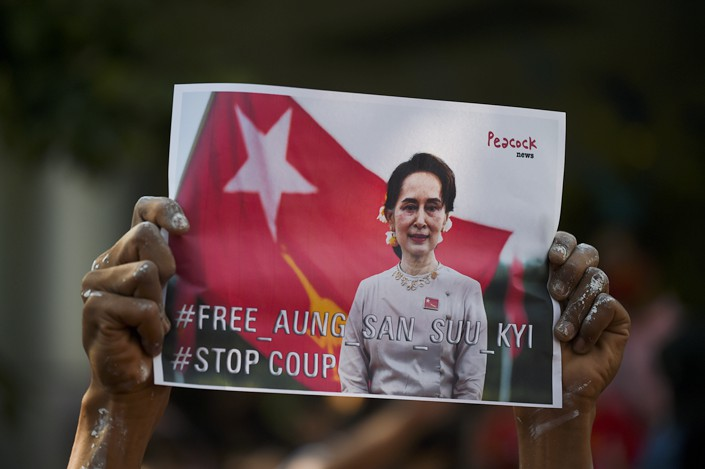 Michael: Myanmar demonstrators hold up portraits of Aung San Suu Kyi during a protest Monday against a military coup at the Myanmar Embassy in Bangkok, Thailand. Photo: VCG