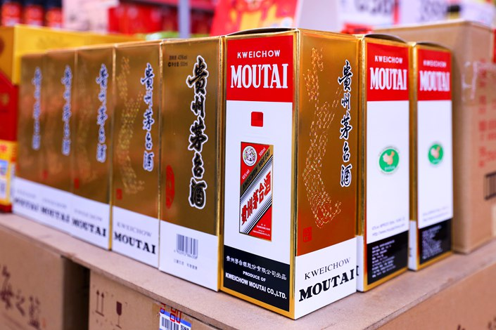 Chinese liquor giant Moutai is taking a series of moves aimed at keeping bottles of its namesake spirit to $230 apiece, even as some sell for double that in the run-up to the Lunar New Year. Photo: VCG