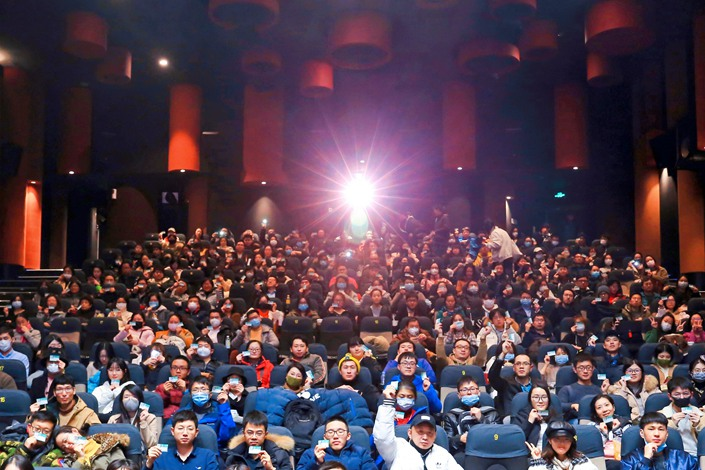 People watch a movie at a cinema in Shenzhen, South China's Guangdong province, on Feb. 13.
