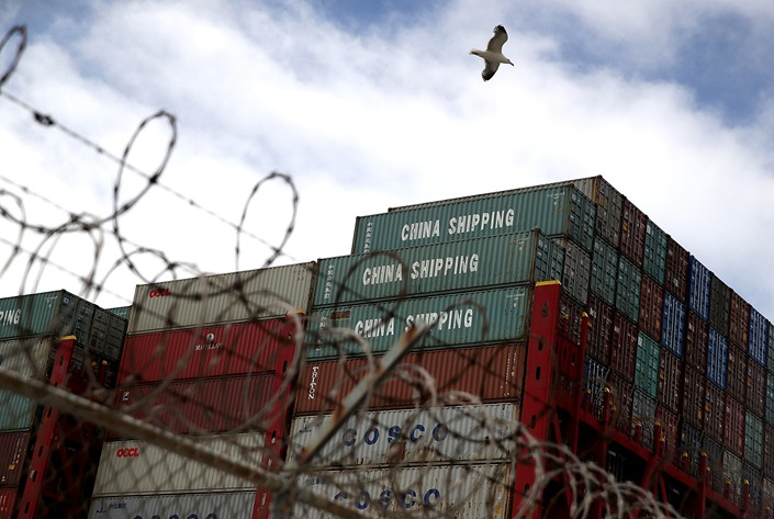 Shipping containers sit on a ship at the Port of Oakland, California, on June 20, 2020.