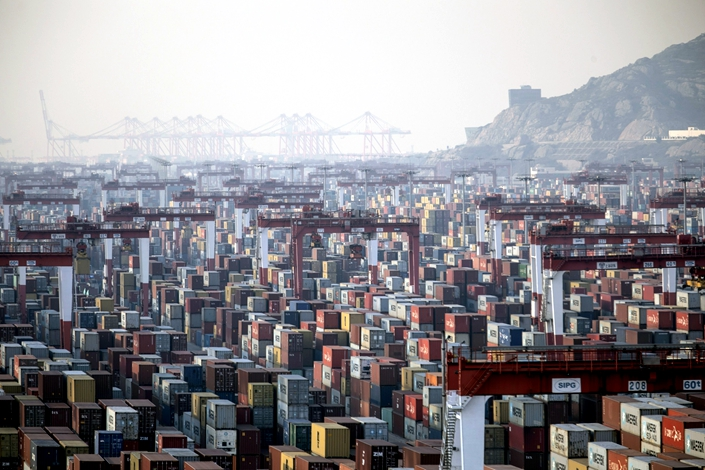 Shipping containers next to gantry cranes at the Yangshan Deepwater Port in Shanghai on Jan. 11. Photo: Bloomberg