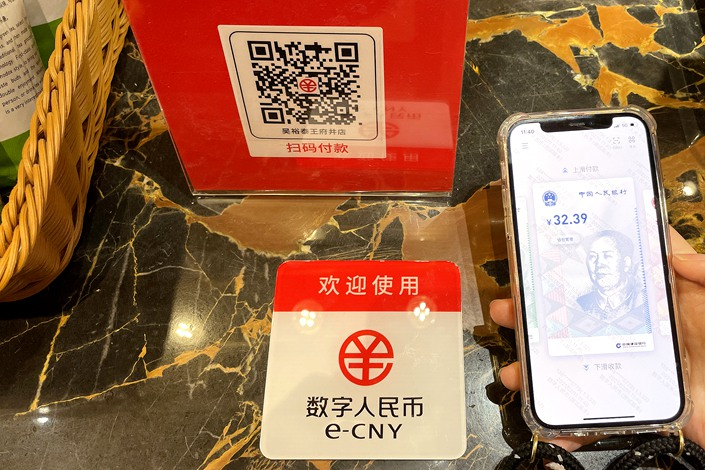 Shoppers pay with the digital yuan at a shopping mall in Beijing on Feb, 11. Photo: VCG