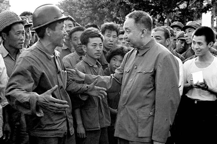 In 1976, Hua Guofeng visited people living in the earthquake-stricken area of Tangshan, North China's Hebei province. Photo: Xinhua