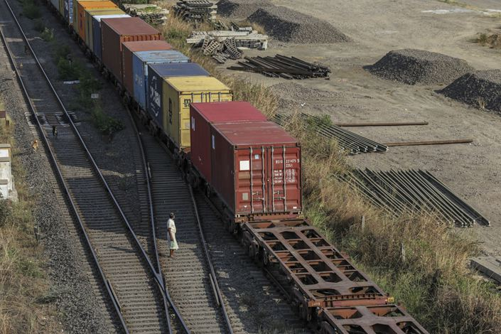 A train carrying shipping containers travels along a track on March 30 near the Jawaharlal Nehru Port in India. Photo: Bloomberg