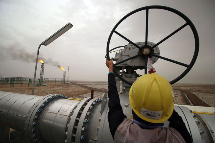 An employee turns a valve at the Zubair oil and gas field, north of the southern Iraqi province of Basra. Photo: Bloomberg