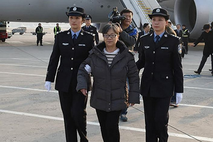 "nullYang Xiuzhu, the No. 1 suspect of China's ""Sky Net"" manhunt operation, returns to China in 2016 to surrender to authorities after 13 years on the lam abroad. Photo: CCTV"