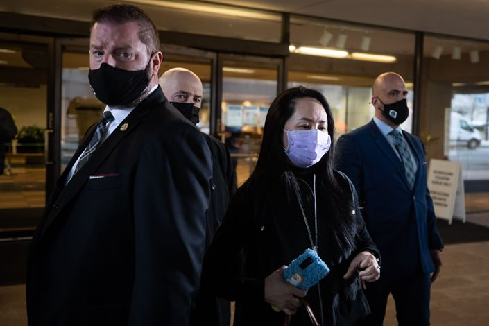 Meng Wanzhou (center), Huawei's chief financial officer, exits the Supreme Court on Friday after a hearing in Vancouver, British Columbia. Photo: Bloomberg
