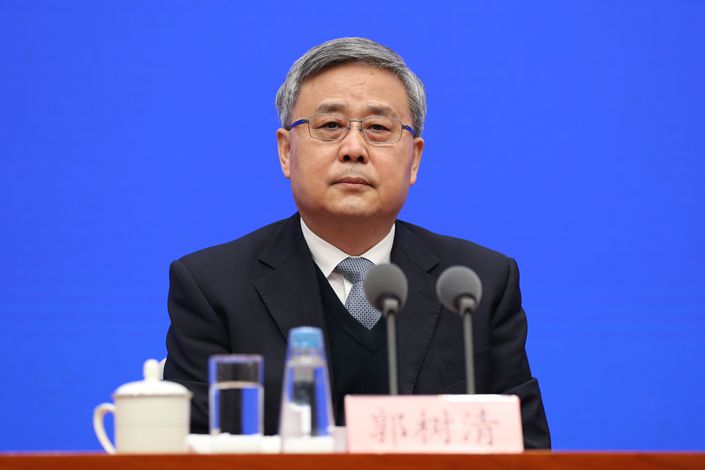 Guo Shuqing, chairman of the China Banking and Insurance Regulatory Commission, attends a press conference held by the State Council Information Office in Beijing on March 2. Photo: SCIO