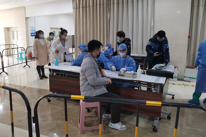 Residents of Beijing's Chaoyang district receive Covid-10 vaccinations Feb. 24.
