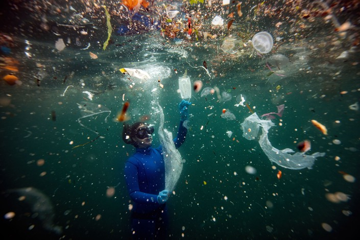 Turkish world record-holder free-diver and divers of the Underwater Federation Sahika Encumen dives amid plastic waste in Ortakoy coastline to observe the life and pollution of Bosphorus in Istanbul, Turkey on June 27, 2020.  Photo: Bloomberg