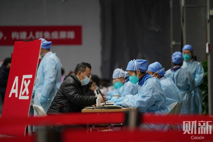 Residents of Beijing's Chaoyang district are vaccinated against Covid-19 on Jan. 5. Photo: Caixin