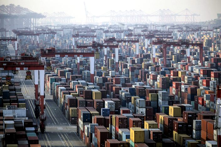 Shipping containers next to gantry cranes at the Yangshan Deepwater Port in Shanghaiy on Jan, 11, 2021. Photo: Bloomberg